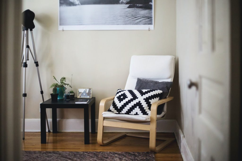 white chair in room with interior designs