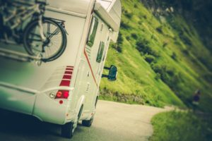 Camper on the road with a custom made mattress inside.
