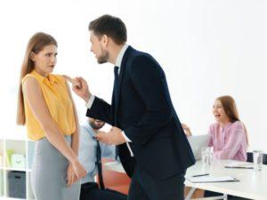 man bullying female employee